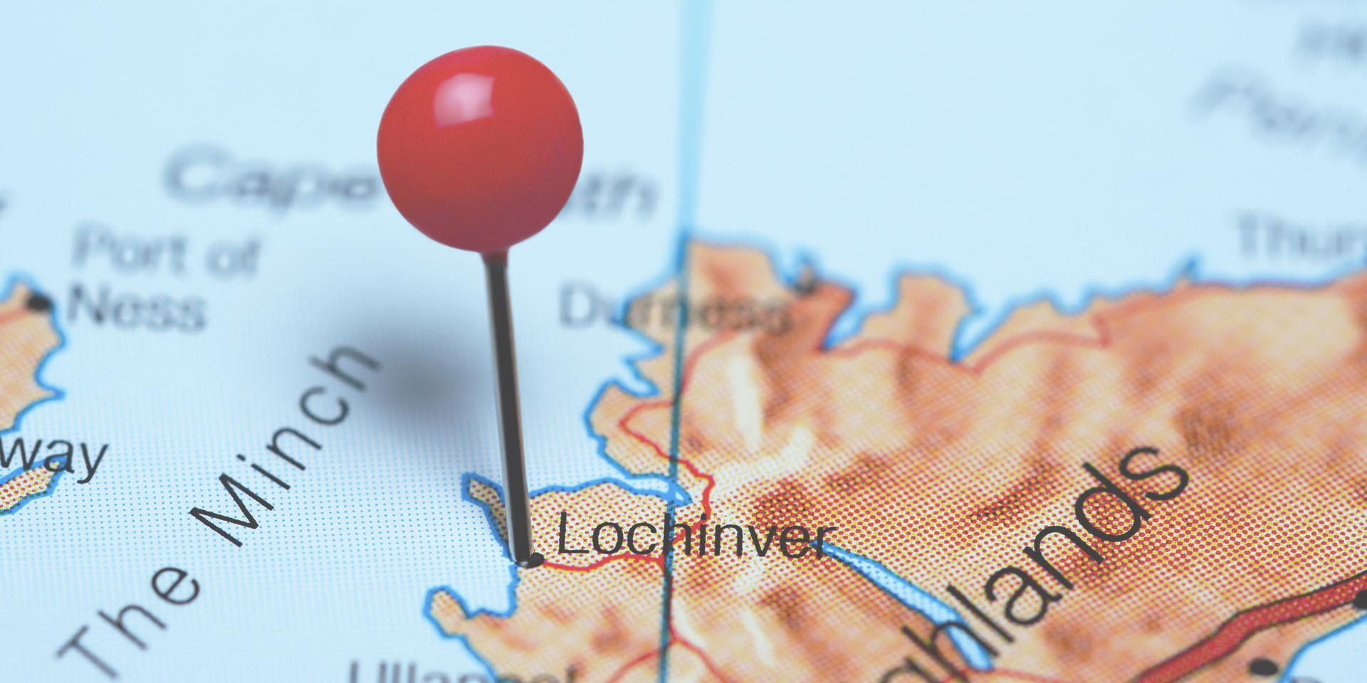 Lochinver pinned on a map of Scotland